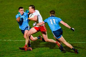 Colm Cavanagh of Tyrone in action against Brian Howard and Seán Bugler of Dublin. Photo: Oliver McVeigh/Sportsfile