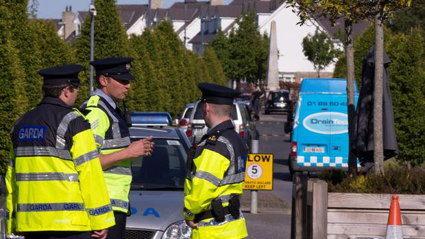 Gardai at the scene of yesterday's tragedy. Picture: Arthur Carron