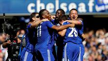 (L-R) Chelsea's Serbian defender Branislav Ivanovic, Chelsea's Ivorian striker Didier Drogba, Chelsea's French defender Kurt Zouma and Chelsea's English defender John Terry celebrate after the English Premier League football match between Chelsea and Crystal Palace at Stamford Bridge