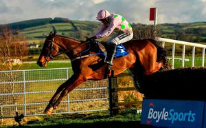 Douvan with Ruby Walsh up, jump the last on their way to winning the BoyleSports Tied Cottage Steeplechase at Punchestown Racecourse in Naas, Co. Kildare. Photo by Ramsey Cardy/Sportsfile