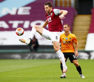 Burnley's James Tarkowski brings the ball down in front of Wolves' Daniel Podence. Photo: Reuters