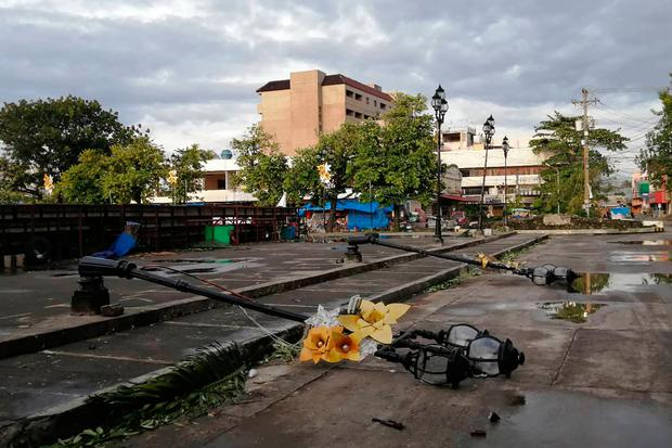 Lamp posts damaged due to typhoon Phanfone lie on a road in Ormoc City, Leyte province in central Philippines on December 25, 2019. (Photo by RONALD FRANK DEJON/AFP via Getty Images)