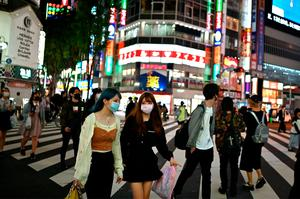 People wearing masks on the streets of Tokyo. Photos: AFP via Getty