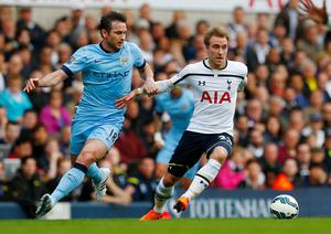 Tottenham's Christian Eriksen in action with Manchester City's Frank Lampard