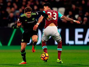 Chelsea's Marcos Alonso attempts to bypass West Ham United's Jose Fonte Photo: Simon Cooper/PA Wire