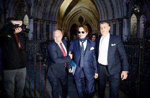 Actor Johnny Depp leaves the High Court in London, Britain, February 26, 2020. REUTERS/Henry Nicholls