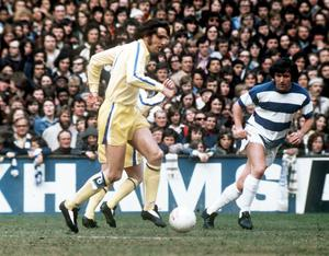 Leeds United's Norman Hunter in action with Queens Park Rangers Terry Venables. The legendary defender has died after contracting Covid-19. Action Images via Reuters