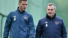 Republic of Ireland's James McCarthy speaks with Dr. Alan Byrne after he sat out squad training