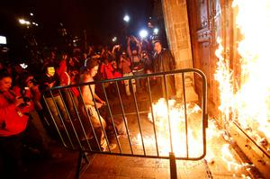 A group of protesters set fire to the wooden door of Mexican President Enrique Pena Nieto's ceremonial palace, during a protest denouncing the apparent massacre of 43 trainee teachers, in the historic center of Mexico City late November 8, 2014.The group, carrying torches, broke away from what had been a mostly peaceful protest demanding justice for the students, who were abducted six weeks ago and apparently murdered and incinerated by corrupt police in league with drug gang members (REUTERS/Edgard Garrido)