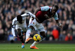 Swansea City's Nathan Dyer battles with West Ham United's Guy Demel