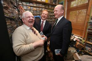 Councillor David Fitzgerald with Taoiseach Enda Kenny and Johnny Barry, a broadcaster with KCLR, looking at Johnny's music collection in his home in Kilkenny. Photo: Damien Eagers