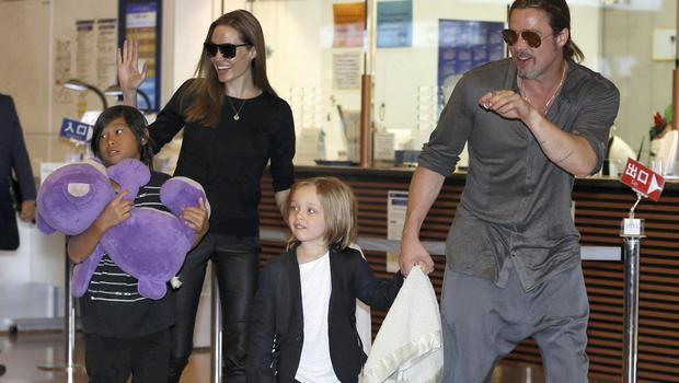 Brad Pitt, right, and Angelina Jolie, second left, along with their children