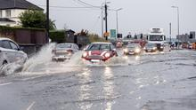 Cars trying to drive through floods at Duck Street on Friday morning last (26th). Pics; Donal Hackett