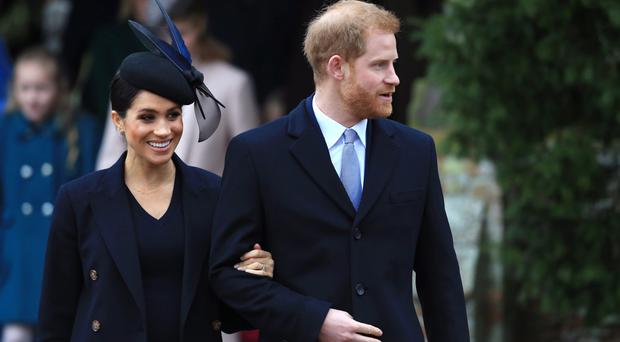 Meghan, Duchess of Sussex and Prince Harry, Duke of Sussex leave after attending Christmas Day Church service at Church of St Mary Magdalene on the Sandringham estate on December 25, 2018 in King's Lynn, England. (Photo by Stephen Pond/Getty Images)