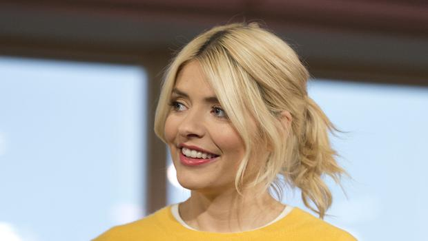 Holly Willoughby wore a long fitted gown (Isabel Infantes/PA)