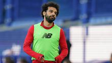 Liverpool substitute Mohamed Salah warms up during Sunday's Merseyside derby clash with Everton at Goodison Park. The Egyptian striker should return to the first team in Wednesday's clash with Crystal Palace.