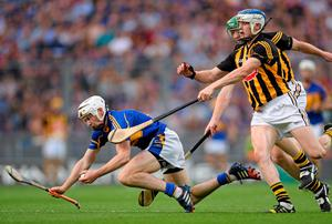 Brendan Maher, Tipperary, in action against Henry Shefflin and TJ Reid, Kilkenny