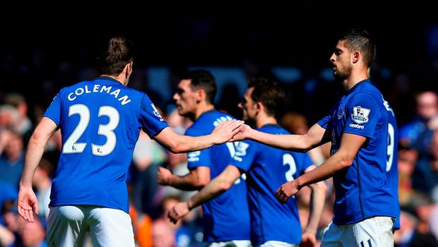 LIVERPOOL, ENGLAND - APRIL 18: Seamus Coleman of Everton congratulates Kevin Mirallas of Everton on scoring the opening goal during the Barclays Premier League match between Everton and Burnley at Goodison Park on April 18, 2015 in Liverpool, England.  (Photo by Clive Brunskill/Getty Images)