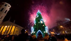 Fireworks light the sky above the Cathedral Square in Vilnius, Lithuania shortly after midnight during the New Year celebrations, Friday, Jan. 1, 2016. Thousands of people celebrated the beginning of the New Year 2016 in the Lithuanian capital. (AP Photo/Mindaugas Kulbis)