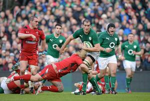 Devin Toner is tackled by Richard Hibbard as Ireland push forward against the Welsh at the Aviva Stadium