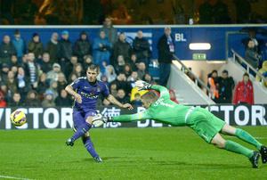 Manchester City's Sergio Aguero scores his sides second goal of the game