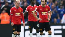 Wayne Rooney, Tyler Blackett and Daley Blind show their irritation during Leicester's stunning comeback against Manchester United.  Photo credit: Mike Hewitt/Getty Images