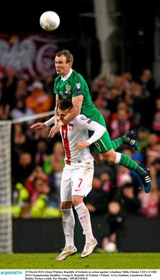 29 March 2015; Glenn Whelan, Republic of Ireland, in action against Arkadiusz Milik, Poland. UEFA EURO 2016 Championship Qualifier, Group D, Republic of Ireland v Poland. Aviva Stadium, Lansdowne Road, Dublin. Picture credit: Pat Murphy / SPORTSFILE