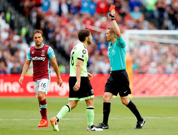 Bournemouth's Harry Arter is shown a red card. Photo: Reuters