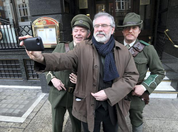 Gerry Adams, TD, President of Sein Fein takes a selfie with Jim Roche and Dave Swift, dressed in the uniform of the Irish Citizen Army at the launch of Sein Fein's National Programme of Events to mark the centenary of the 1916 Rising