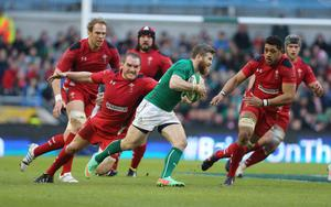 Ireland's Gordon D'Arcy is challenged by Wales's Gethin Jenkins during the RBS 6 Nations match at the Aviva Stadium