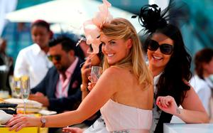 Guests pose for a picture as they arrive at the Meydan racecourse before the start of the ten million US dollars Dubai World Cup, the world's richest horse race