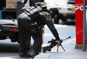 A sniper sets up on Philip Street at Martin Place in Sydney. Photo: Don Arnold/Getty Images