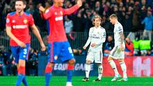 Real Madrid's Luka Modric and Toni Kroos react as CSKA Moscow's players celebrate their victory at the Luzhniki stadium. Photo: AFP/Getty Images