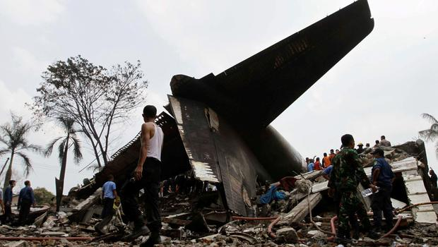 Security forces and rescue teams examine the the wreckage of an Indonesian military C-130 Hercules transport plane after it crashed into a residential area in the North Sumatra city of Medan, Indonesia. Reuters/Roni Bintang