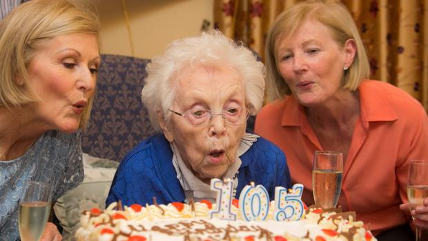 Elizabeth Dempsey and her nieces Miriam Scott and Anita Fitzgibbon celebrate her 105th birthday as part of Nursing Homes Week 2015 in Ailesbury Nursing Home, Park Avenue, Sandymount, Dublin. Photo: Gareth Chaney, Collins