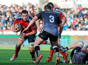 Munster's CJ Stander looks for a way past Aaron Jarvis, Ospreys.