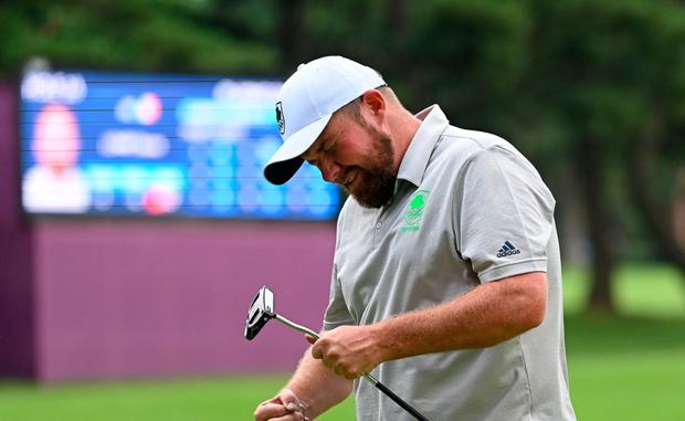 Shane Lowry of Ireland reacts on the 16th