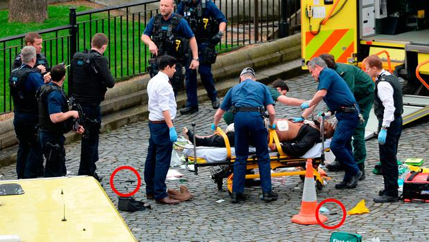 Emergency services bid to save the life of Khalid Masood after his murderous terror attack was ended by an armed policeman at the Palace of Westminster, London