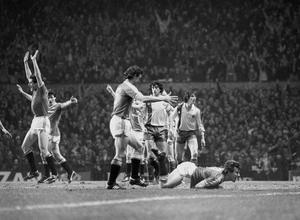 Manchester United's Graeme Hogg, Frank Stapleton and Kevin Moran celebrate after team-mate Bryan Robson scored the opening goal against Barcelona. Photo: PA