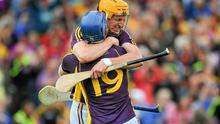 Wexford players Podge Doran, right, and Jack Guiney celebrate after beating Clare in the first round of the Championship. Picture credit: Dáire Brennan / SPORTSFILE