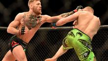McGregor, left, in action against Dennis Siver. UFC Fight Night, Conor McGregor v Dennis Siver, TD Garden, Boston, Massachusetts, USA. Picture credit: Ramsey Cardy / SPORTSFILE