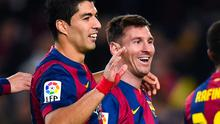 Lionel Messi celebrates with teammate Luis Suarez after scoring Barcelona's fifth goal in their La Liga clash with Cordoba at the Camp Nou. Photo: David Ramos/Getty Images
