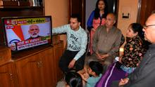 A familywatches Indian Prime Minister Narendra Modi's address to the nation on television at their home in Amritsar. Photo: AFP via Getty Images
