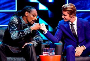 Rapper Snoop Dogg (L) and honoree Justin Bieber onstage at The Comedy Central Roast of Justin Bieber at Sony Pictures Studios