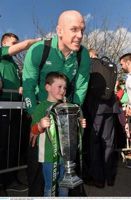 22 March 2015; Ireland captain Paul O'Connell is pictured with supporter Aidan Shanagher, Dundrum, Dublin, upon the team's arrival at Dublin Airport after beating Scotland to win the RBS Six Nations Championship. Dublin Airport, Dublin. Picture credit: Brendan Moran / SPORTSFILE