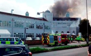 Scene of a fire which has broken out at the Baitul Futuh Mosque in Morden, south London Credit: Doggy Boutique/PA Wire