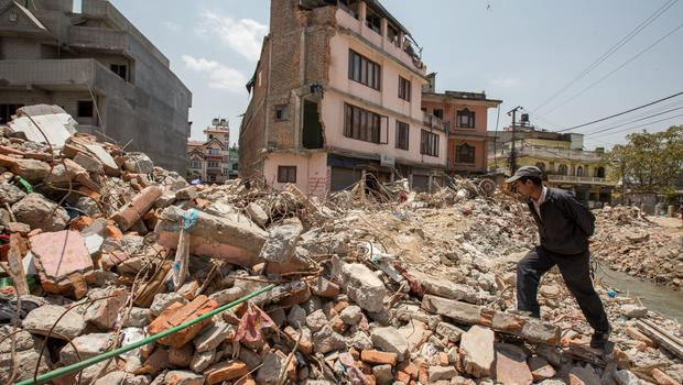A man walks through rubble in Kathmandu, Nepal after the earthquake hit the region. Pic:Mark Condren 1.5.2015