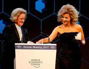 German violinist Anne Sophie Mutter receives the Crystal Award by Hilde Schwab, wife of World Economic Forum (WEF) Executive Chairman and founder Klaus Schwab during the annual meeting of the Forum in Davos, Switzerland January 16, 2017.  REUTERS/Ruben Sprich