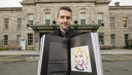 Pop art: Vincent Devine with his painting of Debbie Harry in her book 'Face it'.