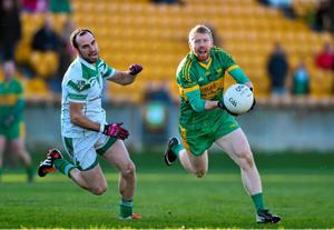 Niall Derby of Rhode in action against Kevin Murnaghan, Moorefield in the AIB Leinster GAA Football Senior Club Championship Semi-Final